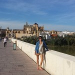 Alicia on the bridge with the Cordoba mosque behind.
